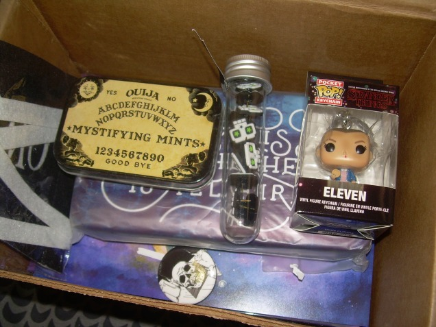 "Stranger Things POP Keychain (Funko), Ouija Mystifying Mints (Boston America Corp) Skull Push pins (OwlCrate Original), Exclusive OwlCrate ""Skull"" Button"